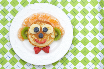 A goofy looking face made of a dental healthy breakfast.